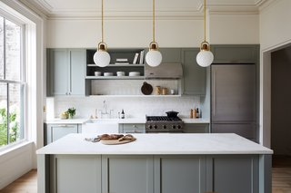 In an effort to keep costs within budget without sacrificing looks, the fully gutted and renovated kitchen features IKEA cabinetry framework with shaker-style fronts by Semihandmade. The cabinets were painted Farrow & Ball Pigeon.