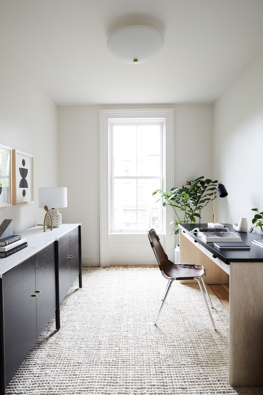 Office, Desk, Study, Chair, Storage, Rug, and Light Hardwood The compact office was wholly redesigned and can be readapted into a nursery, study or even a child's bedroom.   Best Office Rug Light Hardwood Photos from Before & After: A 19th-Century Brooklyn Brownstone Is Saved From Utter Disrepair