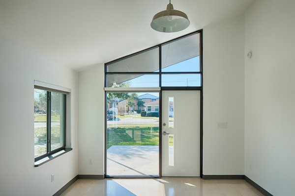 """""""Dramatically angled, clerestory windows above the front and rear doors provide views of the changing sky and let light enter at all times of the day,"""" note the architects."""