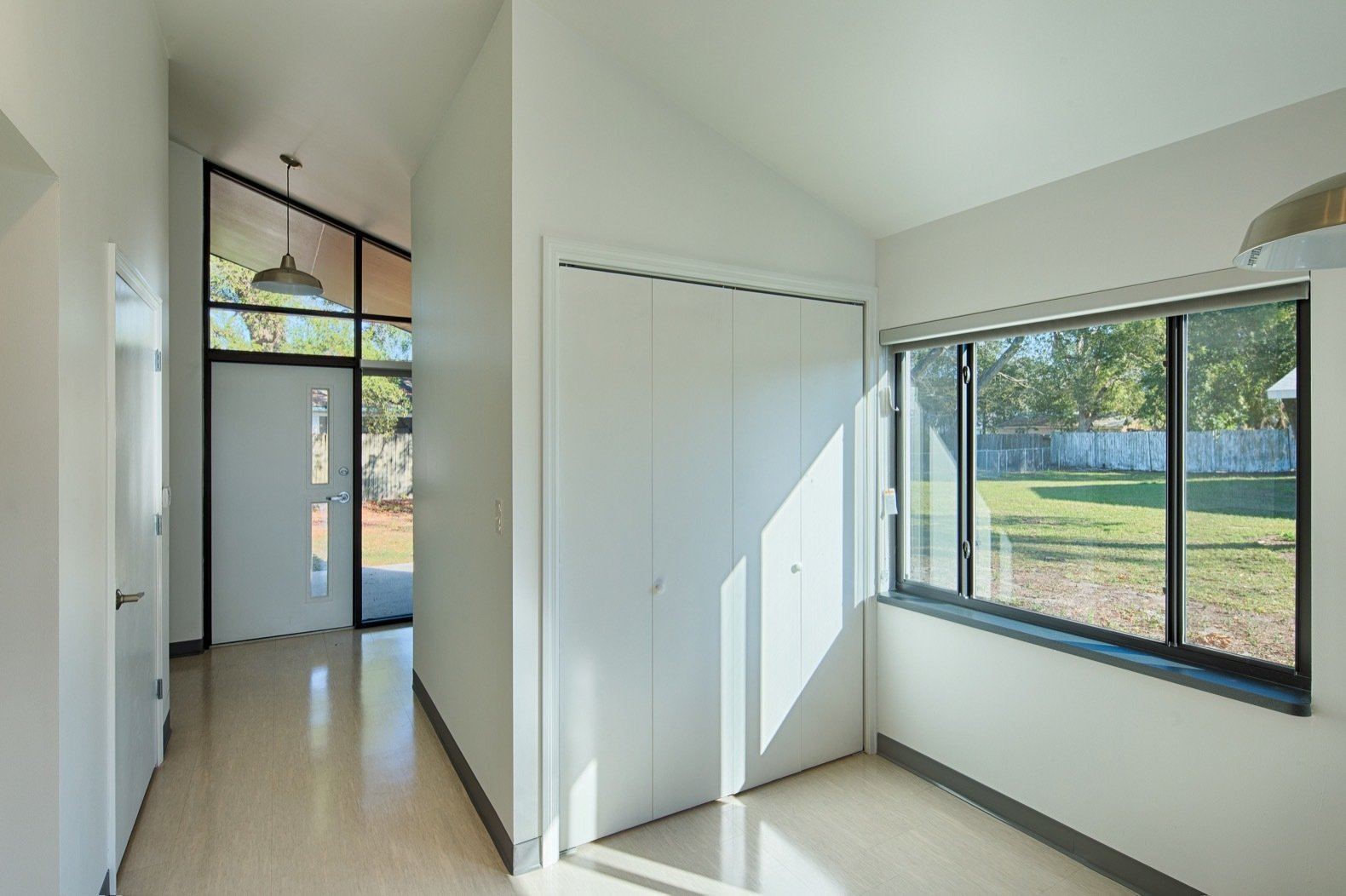 Laundry Room and Concealed The utility, air handler, as well as the washer and dryer units are neatly stored away in the back of the home.  Photo 8 of 14 in Budget Breakdown: These Transitional Homes For At-Risk Clients Cost Less Than $200K