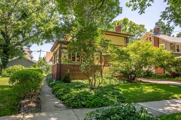 The stucco house is located in a leafy neighborhood just a few blocks from the University of Wisconsin campus.