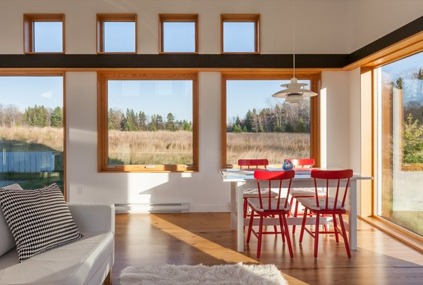 """""""The pine flooring and granite countertops are all made from relatively inexpensive local sources,"""" say the architects, who cite the budget as the most challenging aspect of the project."""