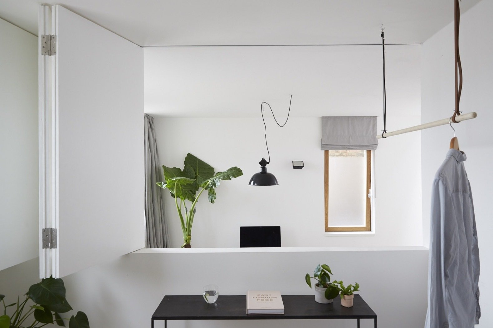 Office and Study Room Type Plants—sourced from Conservatory Archives—breathe life into the minimalist spaces. The lighting fixtures are from Blom & Blom.    Best Photos from A Claustrophobic London Mews House Gets a Smart Redesign