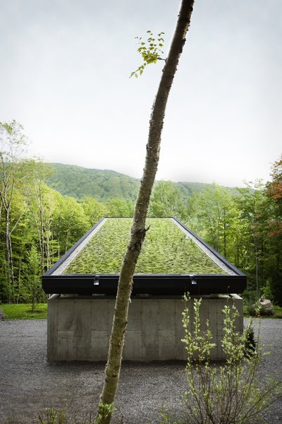 Approached from above, the home blends into the landscape thanks to an expansive green roof that's set on SOPREMA elastomeric waterproofing membrane. In winter, the house is disguised under a blanket of snow.