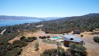 Perched high on a clearing, the Goto House overlooks views of the Napa County hills and Lake Berryessa.