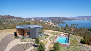 An outdoor pool offers refreshing dips with views of hills blanketed with oaks, pines, and manzanita.