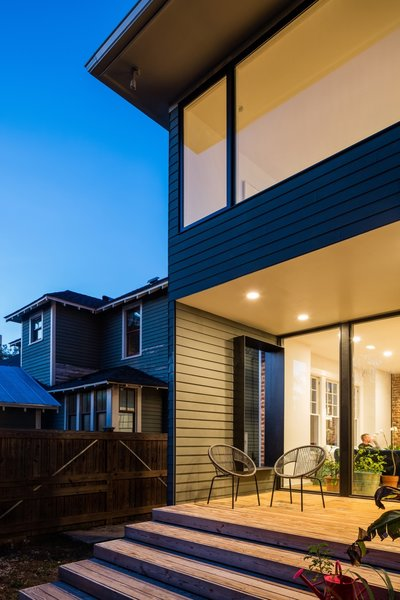 The updated rear of the home features a south-facing deck that's sheltered by the upstairs addition and connects to the main floor living spaces.