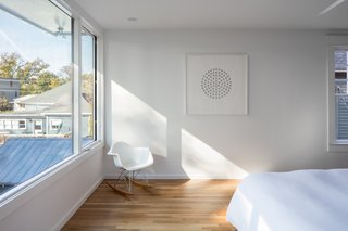 """The bedrooms are completely separate from one another, filled with light, and oriented towards beautiful views of the surrounding context and downtown Raleigh,"" note the architects."