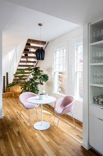 An informal eating space sits beneath the stair and next to the kitchen.