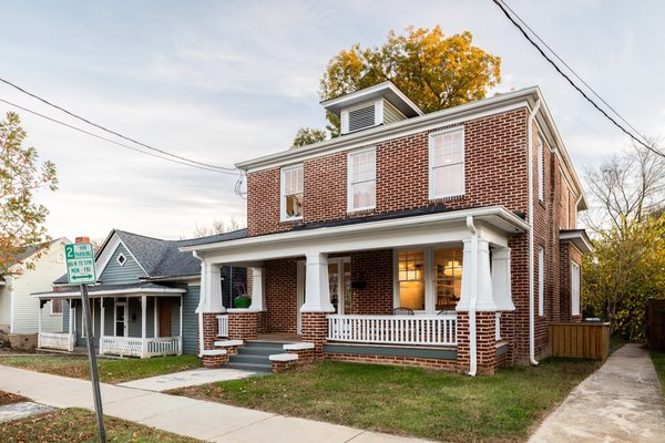 Preserved and repointed brick along with repaired exterior trim and a fresh coat of paint breathe new life into the historic home. The roof is asphalt shingle.