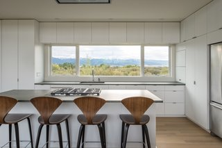 The kitchen counters are Basaltina from Stone Source. The custom cabinets have a white, matte lacquer finish.
