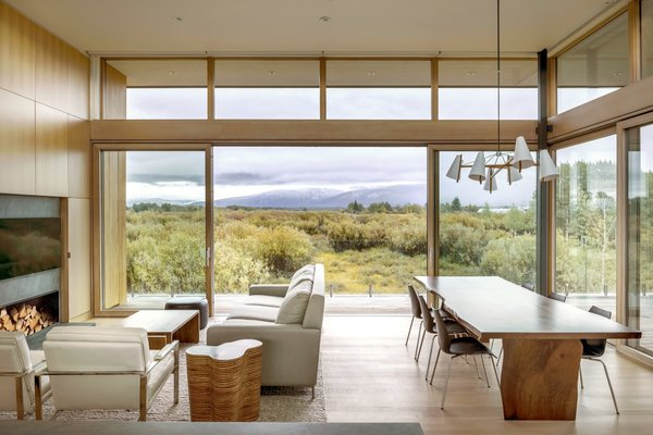 Floor-to-ceiling Lift/Slide doors by Weiland and clerestory glazing usher the outdoors in to the open-plan living and dining areas.
