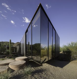 Full-height glazing mainly wraps around the west and south sides of the structure to frame views of Camelback Mountain.