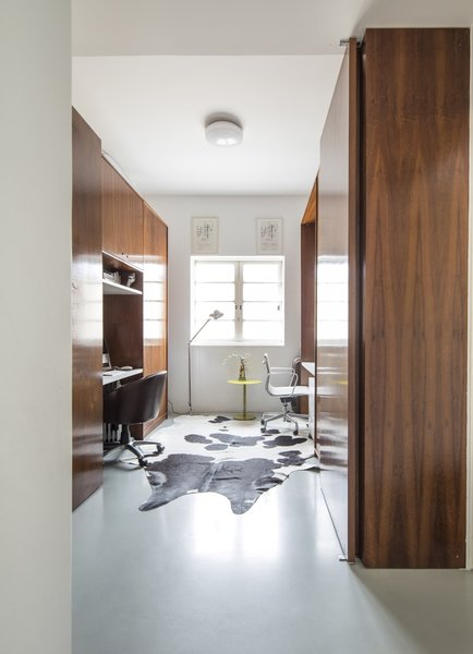 The third bedroom has been converted into a home office with built-in furnishings that serve as walls to divide the office from the bedrooms on either side.
