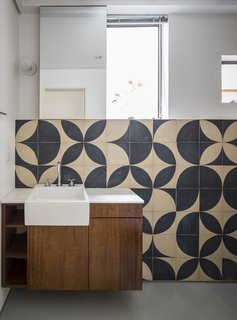 "Local artist Teo Menna designed the pattern for the bathroom cement tile. ""It is an old material that refers back to the time of the construction of the building, but was used with a more contemporary language,"" note the architects."