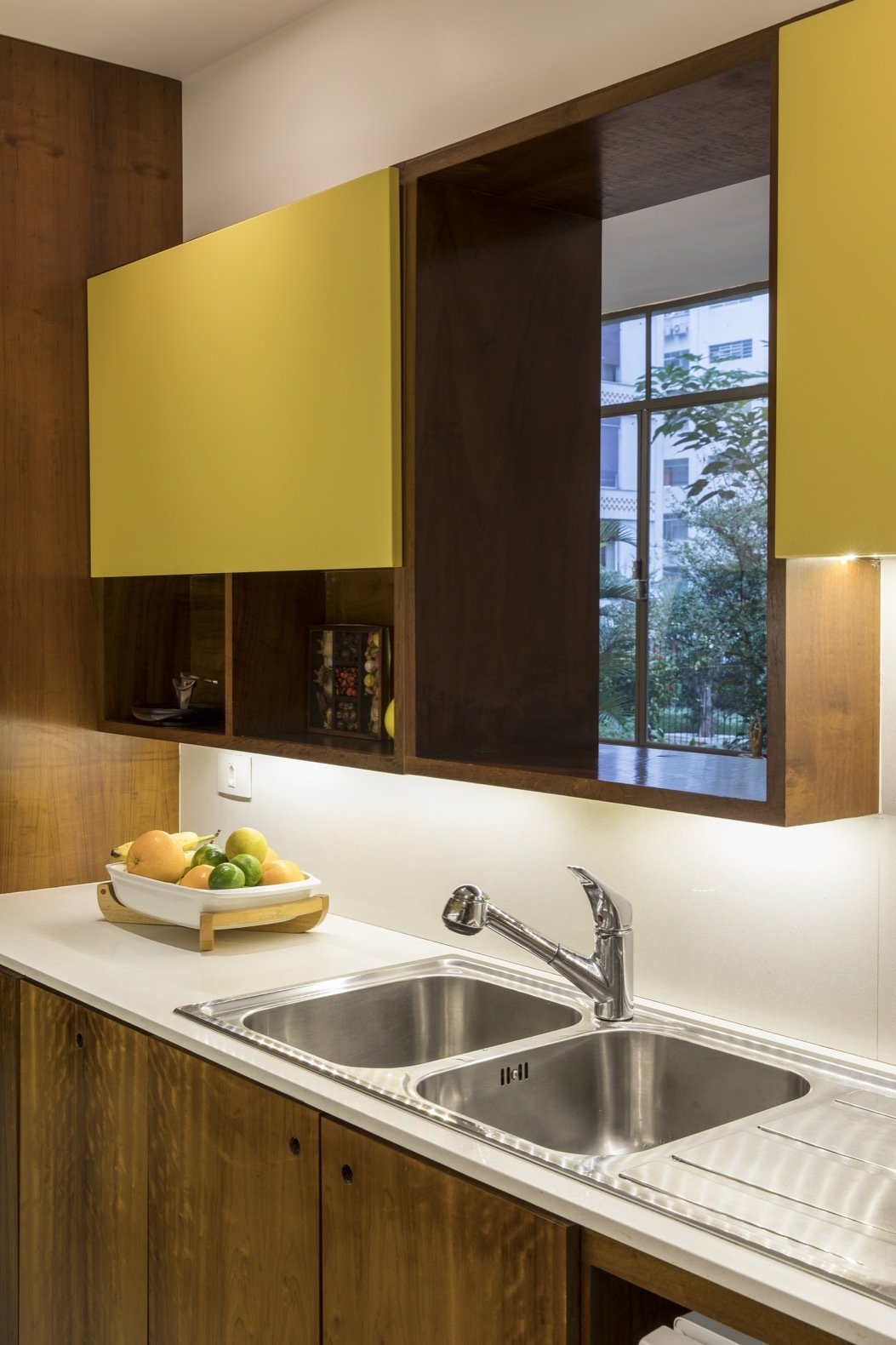 Kitchen, Laminate, Recessed, Marble, Wood, and Drop In An opening above the double sink frames views of the tree canopy.    Best Kitchen Laminate Photos from Greenery Breathes Fresh Life Into a Brazilian Midcentury
