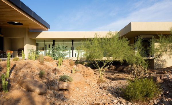 The enclosed bridge allows floodwaters and local wildlife to flow through the desert wash.