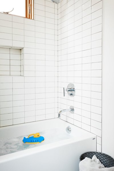 Cost-effective subway tile has been used in the kids' bathrooms.