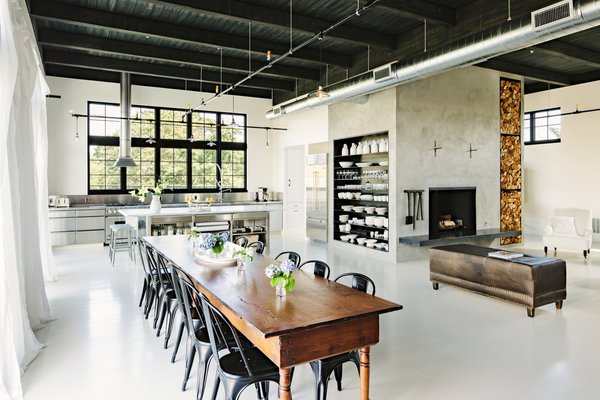 Matte-black Tolix chairs surround a 14-foot harvest dining table that dates back to the 1800s.