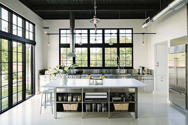 The kitchen island is topped with a five-by-10-foot slab of Carrera marble.