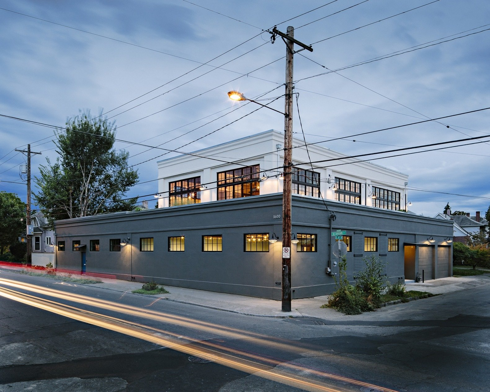 Exterior, Flat RoofLine, and House Building Type Occupying a quarter block, the building had formerly housed a corner grocery, printing press, and mechanic's shop.  Photo 1 of 14 in A 1920s Portland Warehouse Is Rehabbed Into an Industrial-Chic Home