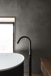 A close up detail of the bath faucet.