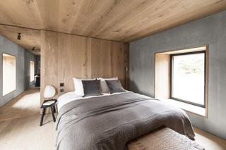 The bedroom is the most pared-back room in the house with just a handful of furnishings including a custom-designed bed.