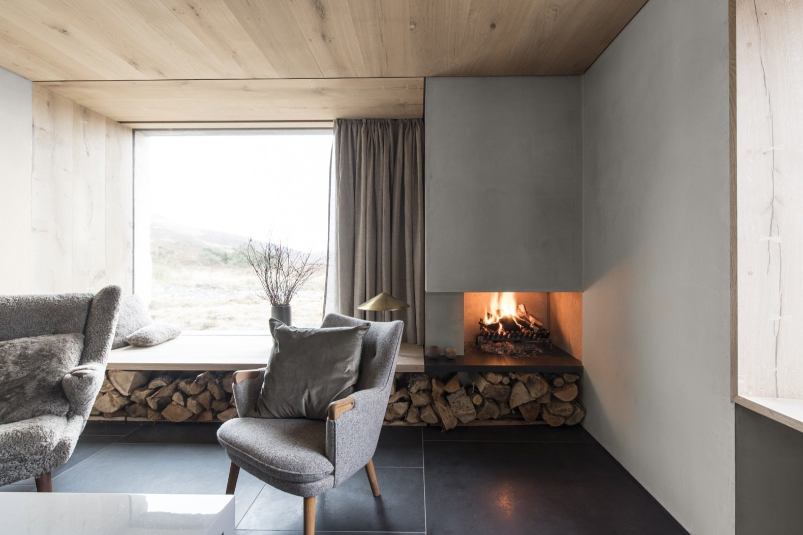 The fireplace is supplied with sustainably sourced timber from the estate.