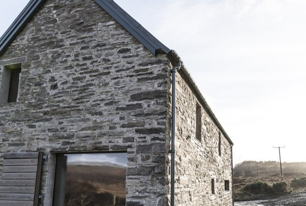 According to the owners, this two-story stone building is the only inhabited house to enjoy uninterrupted views along the length of the sea loch to the North.