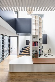 A light-filled spiral stair leads from the dining room to the upstairs lounge.