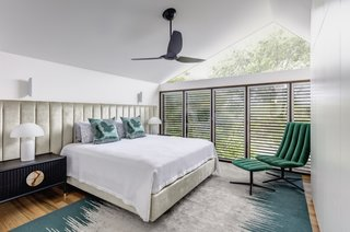 Ample access to natural light and vaulted ceilings give the bedrooms an airy feel.