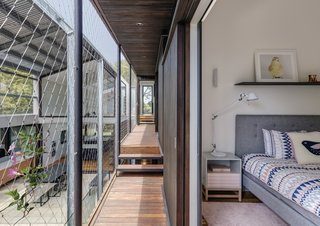 Large sliding doors that divide the bedrooms from the walkway have been built from Western Red Cedar.
