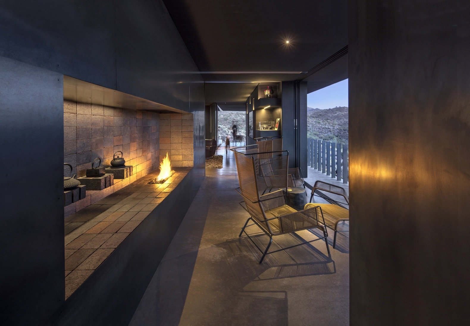 Living, Recessed, Chair, and Concrete A view of the wine/fire lounge looking out toward the entry.  Best Living Recessed Concrete Photos from A Sustainable, Modern Home Frames a Prickly Desert Landscape