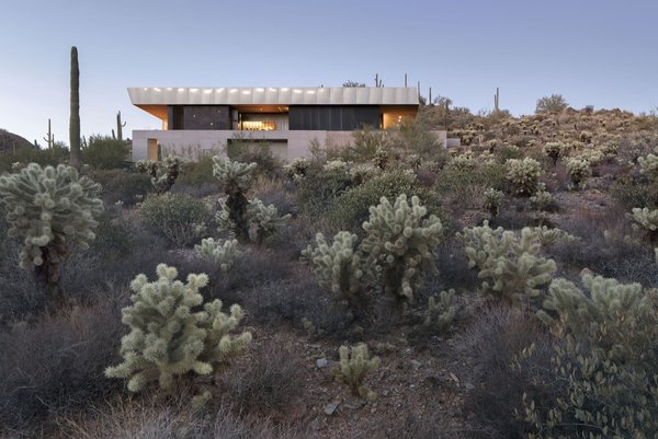 """Approached by clients who wanted to simplify their lifestyle and reconnect with the landscape, Phoenix-based Wendell Burnette Architects designed the Hidden Valley Desert House as a """"long pavilion for living."""""""
