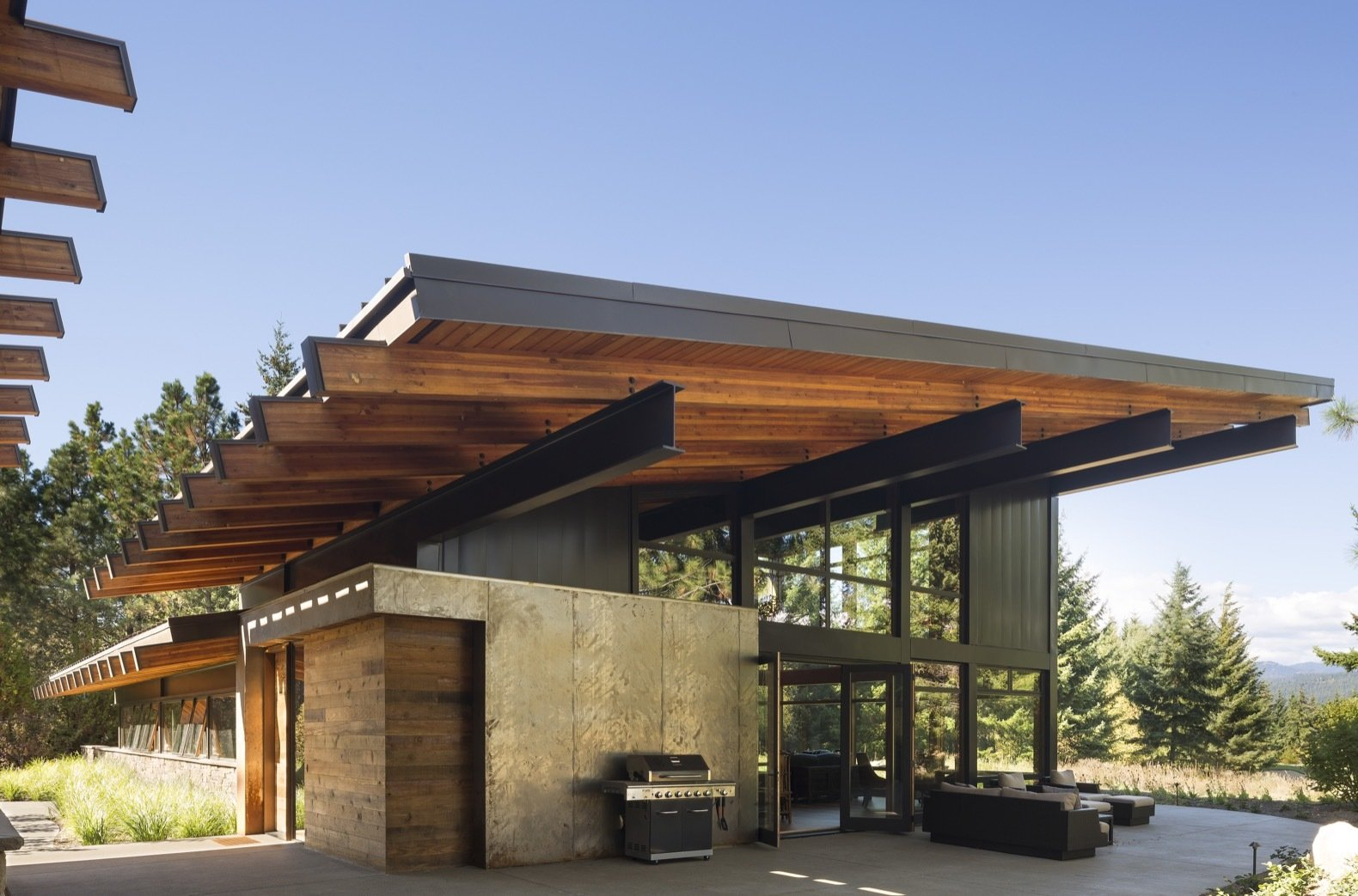 Exterior, Wood Siding Material, House Building Type, Metal Roof Material, Shed RoofLine, Glass Siding Material, and Metal Siding Material This annex houses a large recreation room as well as a guest suite.    Best Photos from A Net-Zero Home Shrugs Off Winter With Solar-Energy Comfort