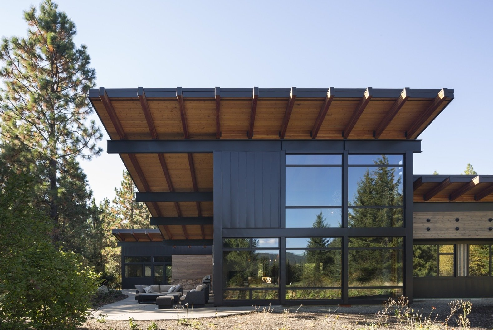Exterior, Wood Siding Material, House Building Type, Metal Siding Material, Metal Roof Material, Shed RoofLine, and Glass Siding Material To recall the region's past as a historic mining town, a rustic palette of mostly natural materials were applied to the home, including stone, Cor-ten steel, and reclaimed barn wood with modern detailing.    Photo 1 of 12 in A Net-Zero Home Shrugs Off Winter With Solar-Energy Comfort