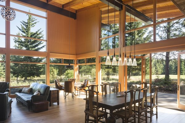 The dramatic, double-height great room is defined by its massive walls of glass that look out to the landscape.