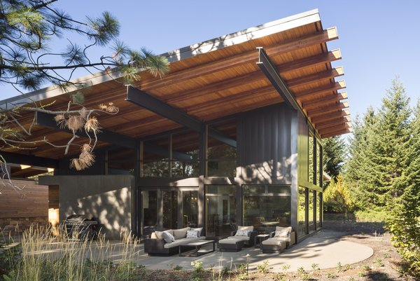 A dramatic cantilevered roof helps mitigate unwanted solar heat gain while inviting in warm winter light.