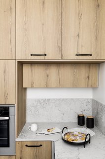 The kitchen countertops are quartz, and the cabinets are Formica.