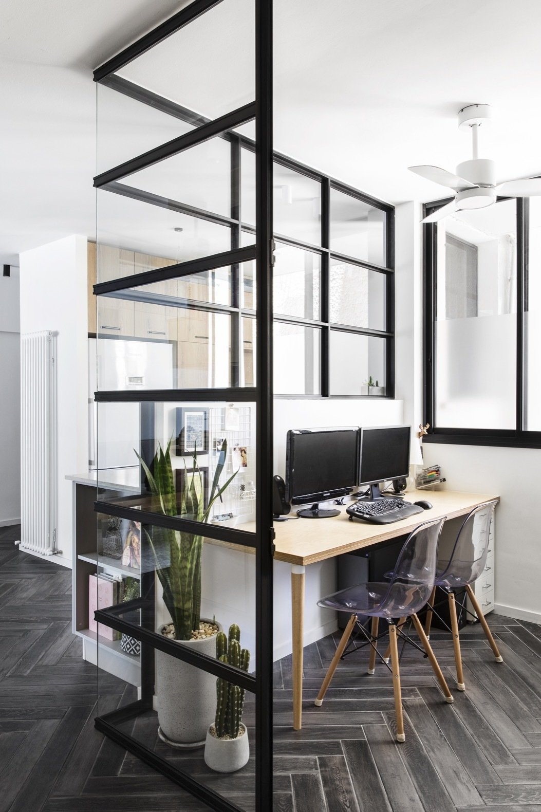Office, Desk, Study Room Type, Porcelain Tile Floor, and Chair The glass-walled study is Efrat's favorite room in her home.  Photo 9 of 21 in Budget Breakdown: A Stunning Apartment Revamp Mixes High and Low For Under $100K