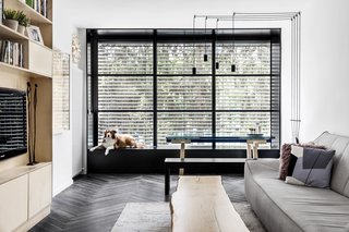 The dining table is the Bonaldo Tracks table, while the dining bench is from IKEA. The window seat provides additional seating.