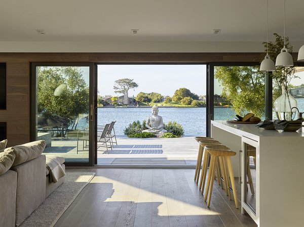 Minimally separated by LaCantina walls of glass, the interior white-washed fumed oak flooring flows into the Alaskan yellow cedar deck built at the same elevation.