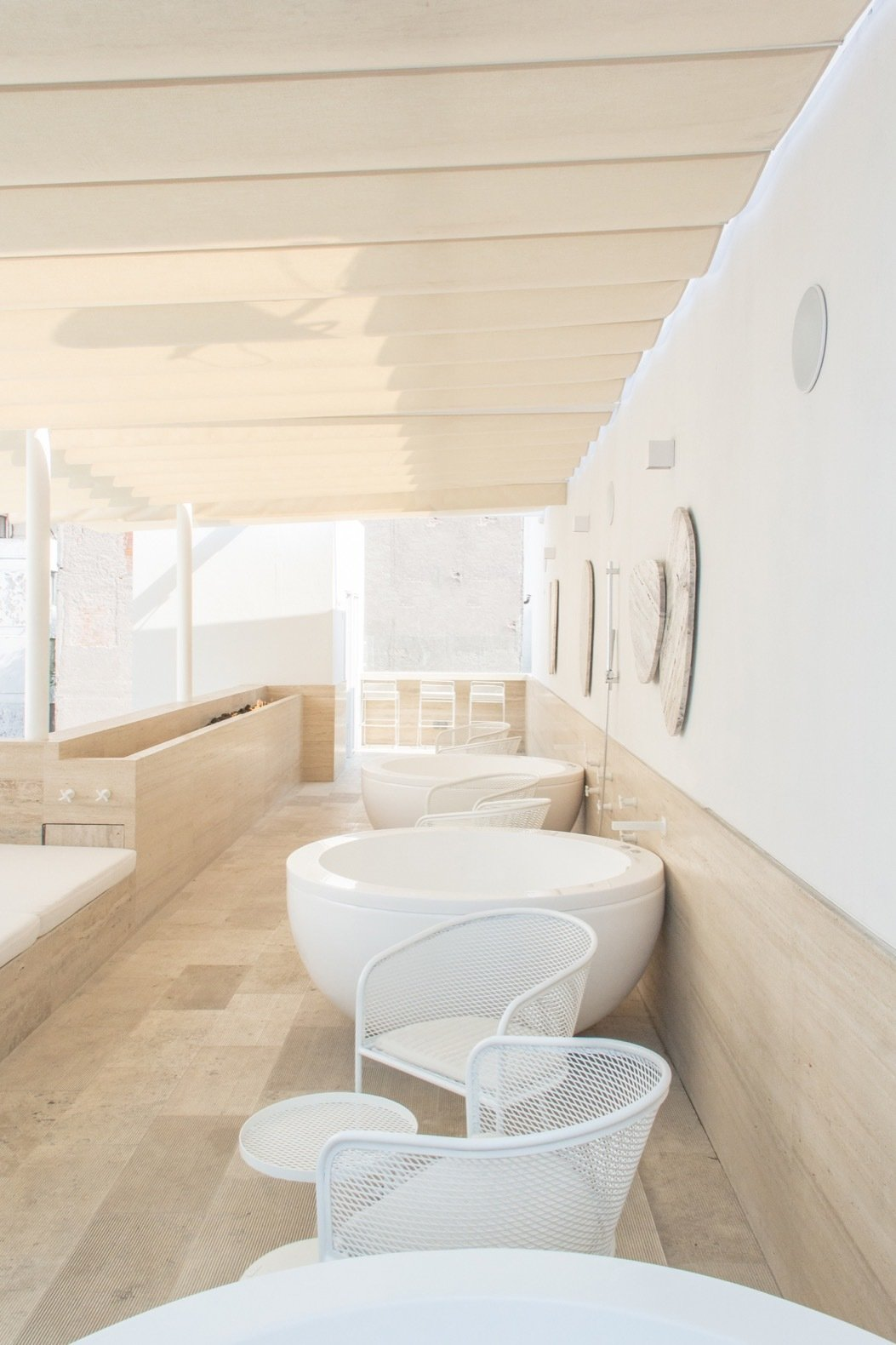 Bath, Light Hardwood, and Freestanding The rooftop deck features four private onsen baths that overlook panoramic city views.    Bath Light Hardwood Freestanding Photos from This Japanese-Inspired Inn Is One of Mexico City's Best Kept Secrets