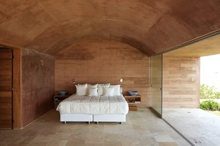 A look inside the master bedroom with a vaulted ceiling.