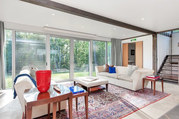 Large sliding glass doors flank both sides of the open-plan living space.