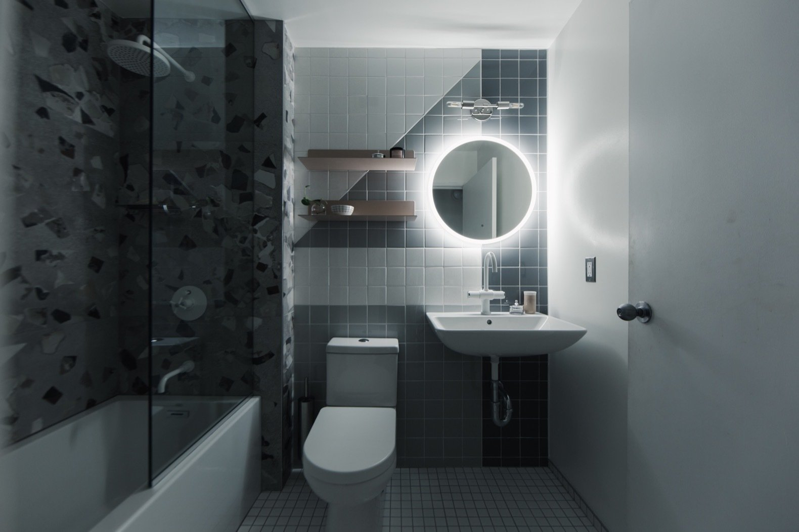 Bath, Porcelain Tile, Two Piece, Wall, Enclosed, Wall Mount, Soaking, Ceramic Tile, and Alcove Recessed cans, a Miseno illuminated mirror, and accent Dutton Brown sconce are all switched separately to provide lighting flexibility.  Best Bath Alcove Ceramic Tile Photos from Budget Breakdown: A Humdrum Bathroom Gets a Retro-Chic Facelift For $17K