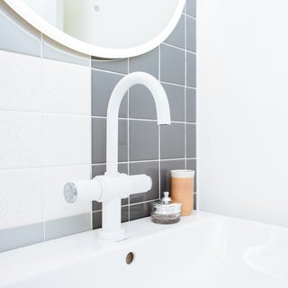 The plumbing fixtures are from Rubinet.