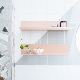The blush pink shelves were sourced from Blu Dot.