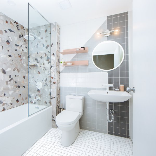 Bath, Two Piece, Soaking, Enclosed, Wall Mount, Ceramic Tile, Wall, Porcelain Tile, and Alcove Storage space was relocated to encourage a more minimalist lifestyle.  Best Bath Enclosed Wall Mount Ceramic Tile Photos from Budget Breakdown: A Humdrum Bathroom Gets a Retro-Chic Facelift For $17K