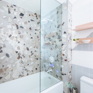 The shower surround tile is I COCCI by Fioranese Ceramica sourced through Olympia Tile/Beaver Tile.